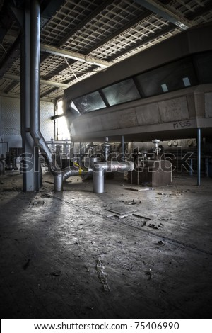 An overview of a operation hall at an abandoned power station, an amazing control room looks over the complete area. - stock photo