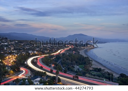 An overview of the 101 freeway at dusk looking east from Santa Barbara, California. - stock photo