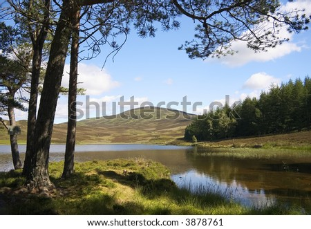 An peaceful inland Scottish Loch in Highland Perthshire - stock photo