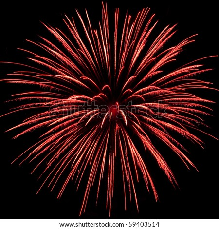 an red firework explosion in the night sky - stock photo