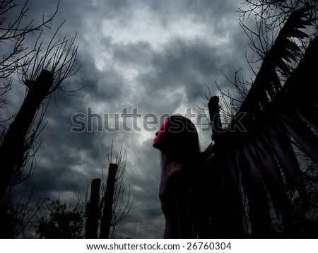 An rendered angel silhouette with unfolded wings on stormy background. Digitally created image with photo as a background. - stock photo