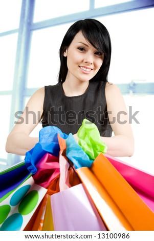 An shot of a beautiful woman carrying shopping bags in a store - stock photo