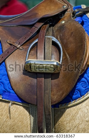 An stirrup on an english saddle used for polo.. - stock photo