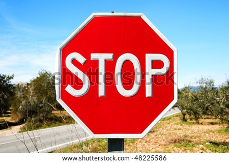 an stop traffic sign in a road