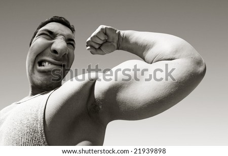 An ugly mean man with big muscles