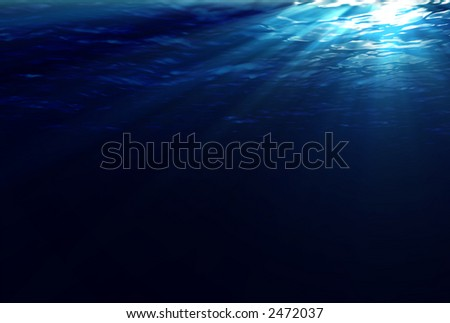 An underwater scene with sunrays shining through the water's glittering and moving surface. (4900x3300) - stock photo