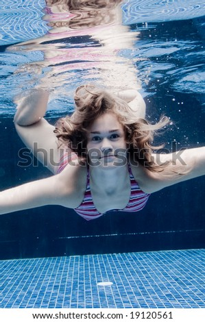 An underwater shot of a woman in a swimming pool