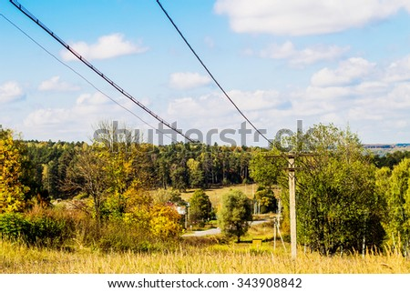An undulating landscape with transmission line in the country, Russia. Image with selective focus