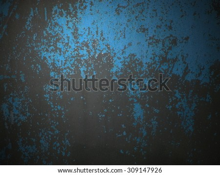 An uneven grunge background with blue and black colours - stock photo