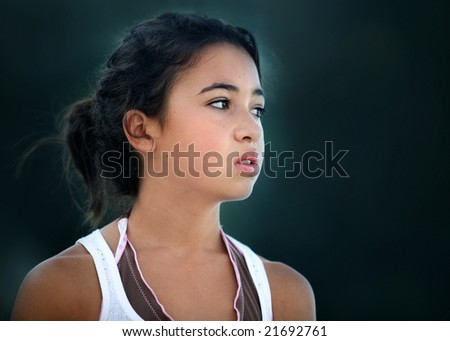 An unhappy teenage asian girl looking sideways - stock photo