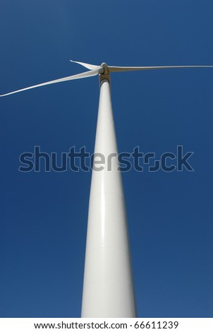 An unusual view looking straight up a huge wind turbine from central Kansas. - stock photo