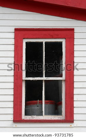 An upper window in the Roberts Store Heritage Building, a Newfoundland Fisheries Heritage building, in Woody Point, Newfoundland, Canada. - stock photo