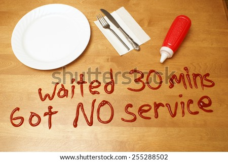 An upset customer has left a messy message for the poor service rendered. - stock photo