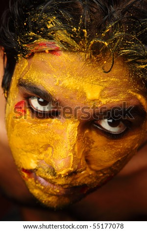 An yellow colored face looking upwards - stock photo
