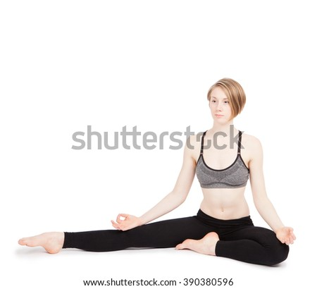 An young woman doing yoga exercise