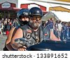 ANACORTES, WA - SEPTEMBER 27: An unidentified couple with motorcycle rides in the 28th annual Oyster Run largest motorcycle run in the Pacific Northwest on September 27, 2009 in Anacortes, WA. - stock photo