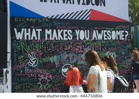 Anaheim, CA - June 23: Fans sign the What Makes You Awesome board at the 7th annual VidCon conference at the Anaheim Convention Center in Anaheim, California on June 23, 2016