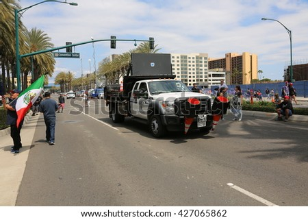 ANAHEIM CALIFORNIA, May 25, 2016: Police in riot gear and cars and vans protect both supporters and protesters from each other during the Republican Nominee Donald J. Trump Rally Anaheim 5.25.2016 - stock photo