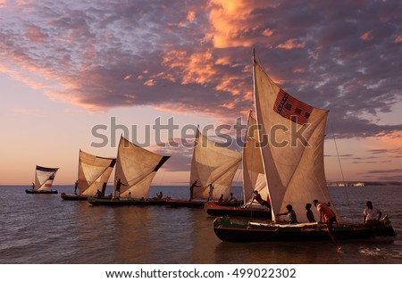 ANAKAO - MADAGASCAR - JUNE 25, 2016: Unidentified fishermen with pirogues on June 25, 2016 in Anakao, Madagascar. Due to a political crisis Madagascar is among the poorest countries in the world