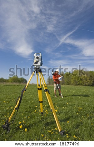 Analizing a map - spring land surveying. - stock photo