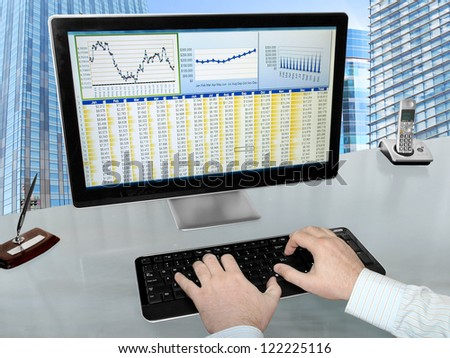 Analizing Data on Computer Male Hands on the Keyboard in Front of Computer Screen with Financial Data and Charts - stock photo