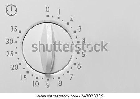 Analog 35 minute microwave oven timer, analogue vintage white dial face macro closeup, grey numbers and icon, large background copy space horizontal - stock photo
