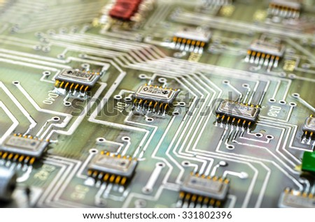 Analog printed circuit board with applied digital effects. Shallow DOF.