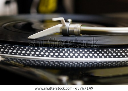 Analog record player spinning the disc with music - stock photo