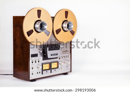 Analog Stereo Open Reel Tape Deck Recorder Player with Metal Reels Reels - stock photo