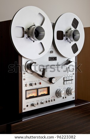 Analog Stereo Open Reel Tape Deck Recorder with large reels - stock photo