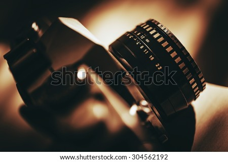 Analog Vintage Camera with Prime Lens Closeup Photo. History of Photography. - stock photo