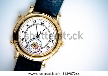 Analog wrist watch closeup on white background - stock photo