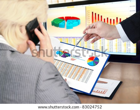 Analysing  financial data and charts. - stock photo