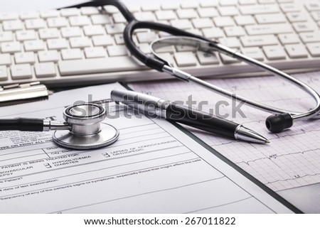 Analysis. Stethoscope on cardiogram concept for heart care on the desk. - stock photo