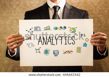 Analytics text with businessman holding a sign board