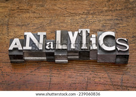 analytics word in mixed vintage metal type printing blocks over grunge wood - stock photo