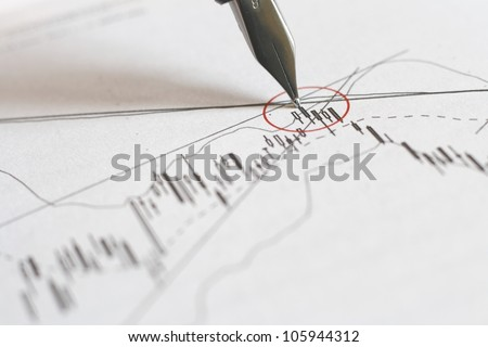 analyzing a chart with pen - stock photo