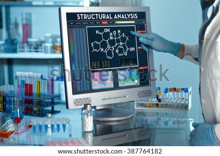analyzing data scientist in the laboratory with a screen project development / researcher touching the screen of report of structural analysis - stock photo