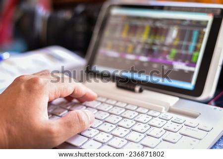 Analyzing Stock Market Status On Digital Tablet - stock photo
