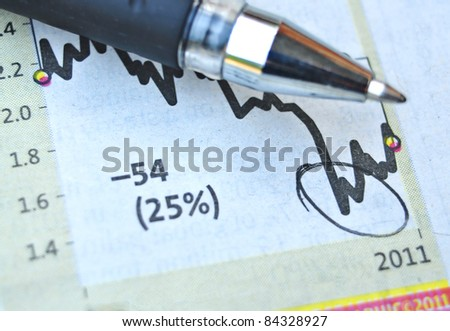 Analyzing the business graph and pointing - stock photo