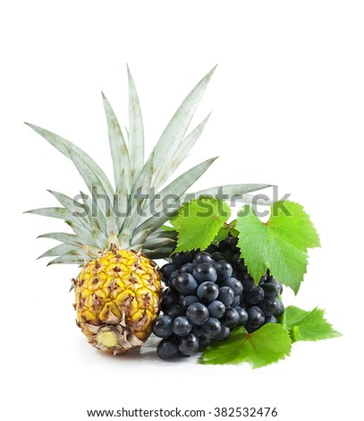 Ananas and grape isolated on white - stock photo