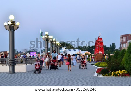 ANAPA, RUSSIA - AUGUST 10, 2015: Unidentified people are walking along embankment in Anapa. Anapa is a resort on the Black Sea Coast, Russia. - stock photo