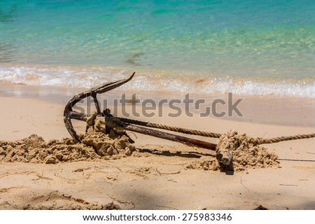 Anchor on a beach for boat anchors - stock photo