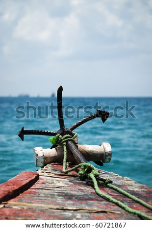 Anchor on the bow of an old Dhow at sea - stock photo