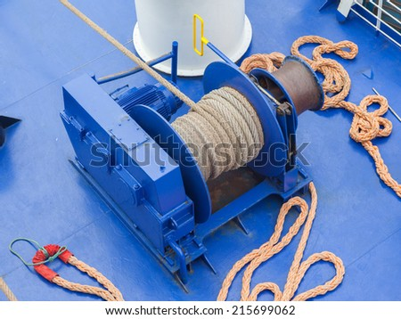 Anchor winches on a large modern ship - stock photo