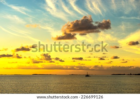 Anchored for the evening in the sea of Abaco - stock photo