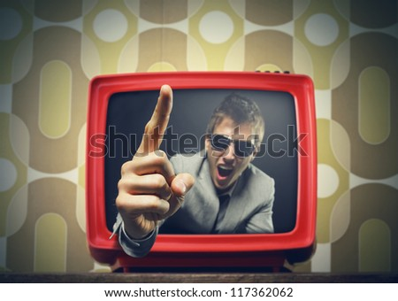 Anchorman pointing his finger and screaming in vintage tv - stock photo