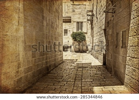 Ancient Alley in Jewish Quarter, Jerusalem. Israel. Photo in old color image style. - stock photo