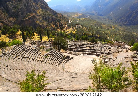 Ancient amphitheater and ruins of Temple of Apollo in the archaeological site of Delphi, Greece - stock photo