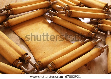 Ancient antique scrolls on the table - stock photo